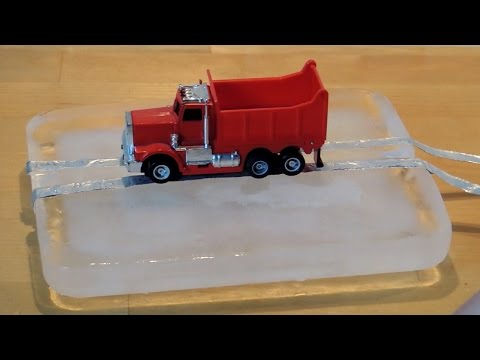 Slot cars on ice, first test with cars from Carrera Go and Tyco on a piece of ice as track