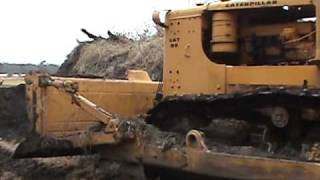 Caterpillar D9 knocking down a small pile of topsoil 2