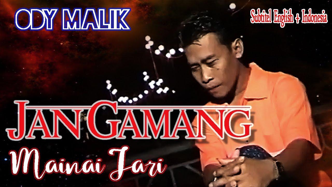 Download Ody Malik || JAN GAMANG MAINAI JARI || Karya Agus Taher  ( Lyrics & Subtitel English + Indonesia )