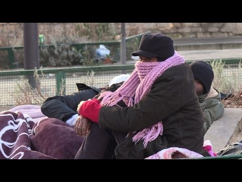 Migrants camp outside Paris shelter hoping to get in