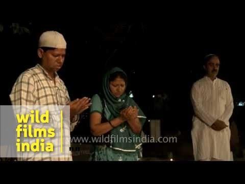 Muslim family offer prayer at a graveyard - Shab-e-barat