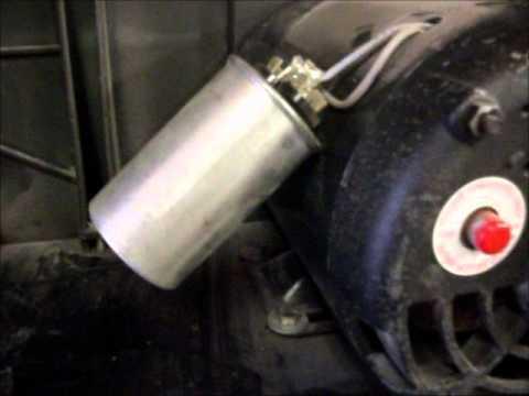 Air compressor motor and capacitors.