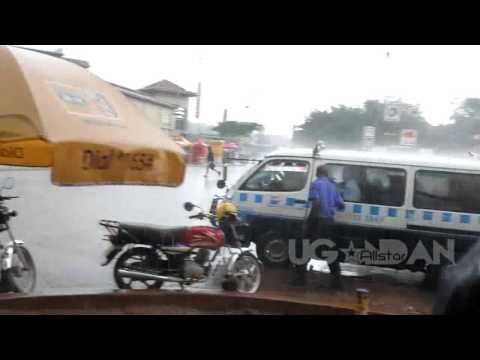 El nino rains in kampala uganda 2015 . women hawk (hustle) umbrellas