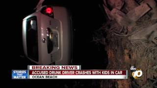 Accused drunk driver crashes with kids in car