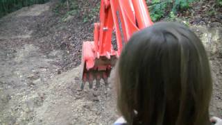 Seven Year Old Girl Running A Backhoe