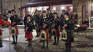 Massed Pipe Bands perform outside the Fife Arms in Braemar for St Andrews Day 2018