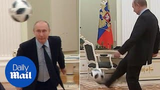 President Putin shows-off footie skills with 100 days to World Cup - Daily Mail