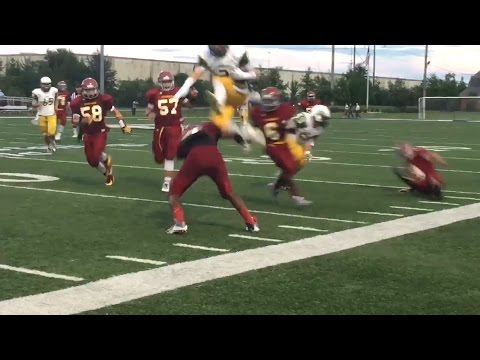 Football player leaps over opponent, scores awesome td