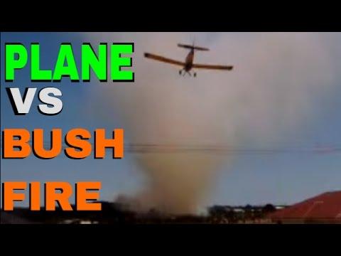 Plane Drops Water Bomb on Bushfire