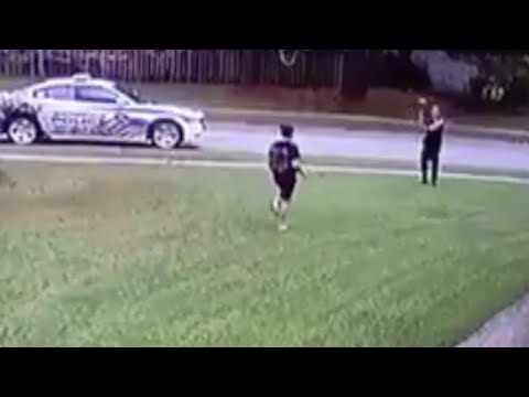 Cop Plays Catch With Boy Tossing Football By Himself