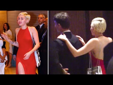 Red Hot Miley Cyrus Shows PDA With Patrick Schwarzenegger At Pre-Grammys Party