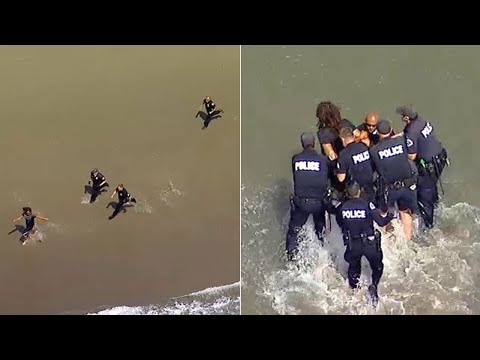 BEACH PURSUIT: Police officers chase man on foot in waves at Venice Beach | ABC7