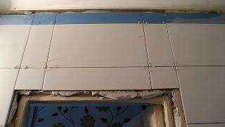 Раскладка плитки над дверью в ванной
