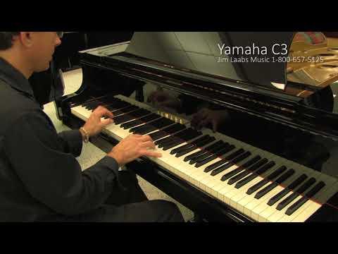 Yamaha console piano oak finish doovi for Yamaha c3 piano review