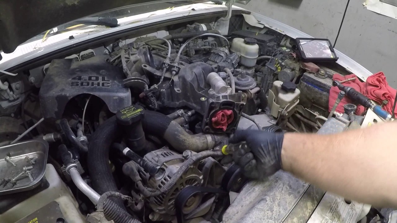 How to replace the thermostat housing on a ford 40 v6