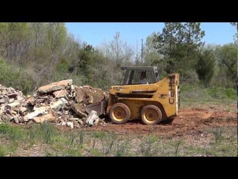gehl-4835-sxt-skidsteer-moving-concrete-pile-(hd)
