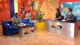 Gaurav Mazumdar plays 'Sitar' at an Indian entertainment show