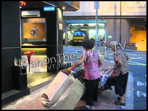 Women Fight Over Boxes in Hong Kong