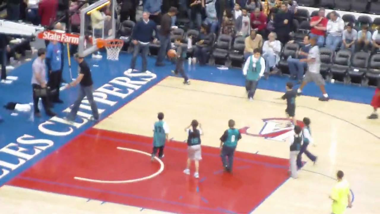 Little Kids Playing A 5 Minute Basketball Game At Halftime