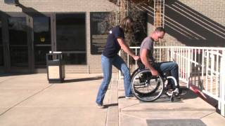 Craig Hospital Wheelchair Skills: How to Assist with Going Up and Down a Curb