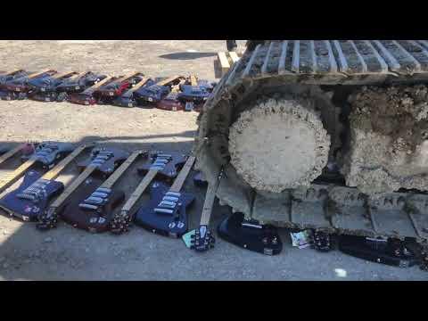 Excavator DESTROYS $500,000 Hundreds of BRAND NEW Gibson Firebird X Guitars!