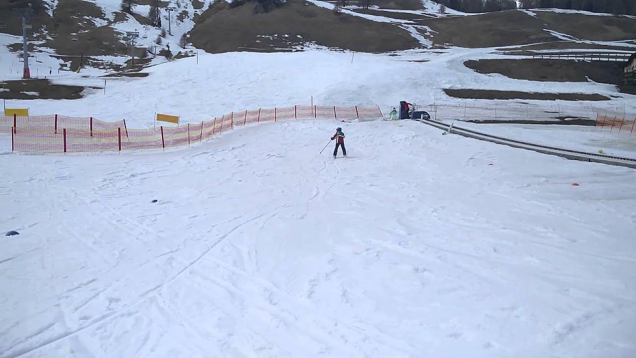 Boys skiing backward