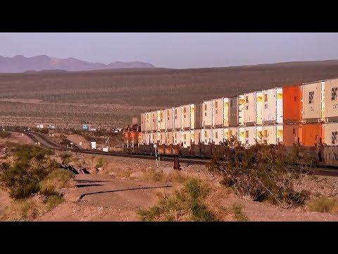 BNSF Diesel triplets lead a JB Hunt container rake near Ludlow, CA in Mojave Desert