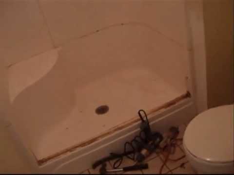 horrible fiberglass shower to nice tiled shower