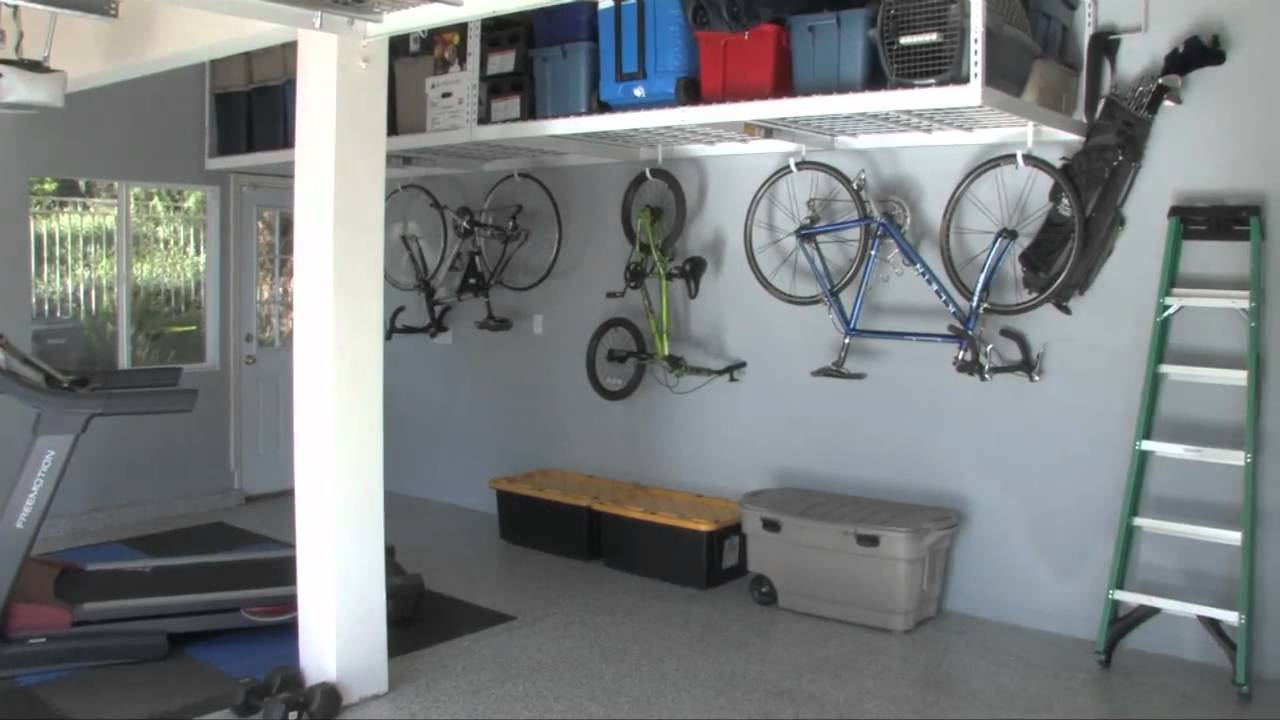 Garage overhead storage racks saferacks youtube for Piani di garage free standing
