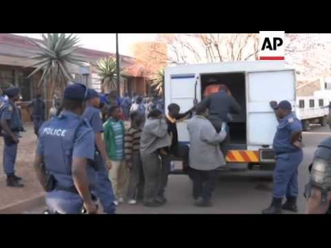 South Africa - 34 killed in shooting at South African mine / Hundreds of miners charged in deaths of