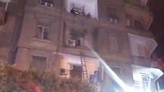 بالفيديو - الحماية المدنية تنقذ ''كلبا'' سقط من شرفة شقة بوسط القاهرة