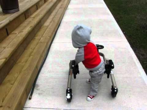 Jakob Walking with walker (arthrogryposis)