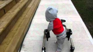 Jakob Walking with walker (arthrogryposis)