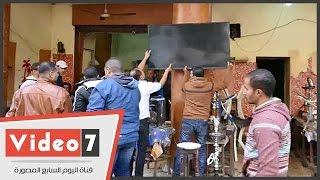حى العجوزة يشن حملة على مقاهى أغلقت مداخل العمارات بشارع الترسانة