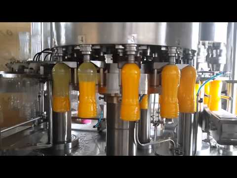 Fully Automatic Synthetic Juice Filling Machine by Venus Packaging Machines Pvt. Ltd.