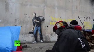 Banksy graffiti w/ Steve Jobs as migrant appears at Calais 'jungle'
