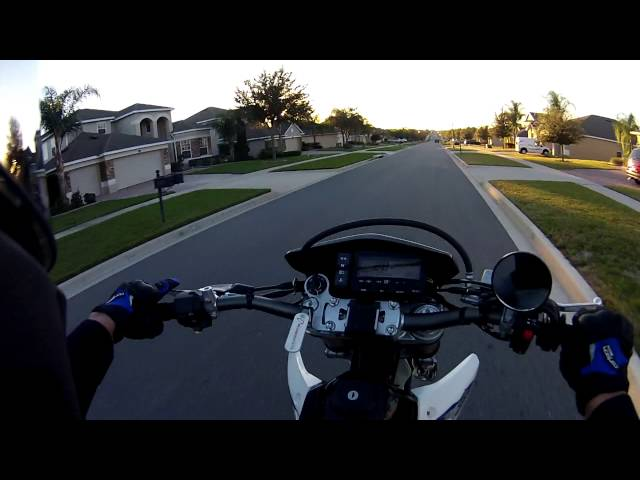 Noob POV Practicing how to pop a wheelie on the DRZ400SM