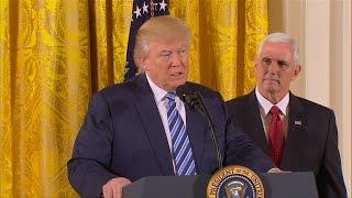 President Trump swears in senior staff