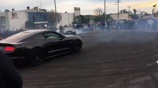Car enthusiast doing donuts
