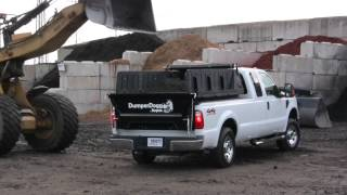 DumperDogg on jobsite being loaded with topsoil