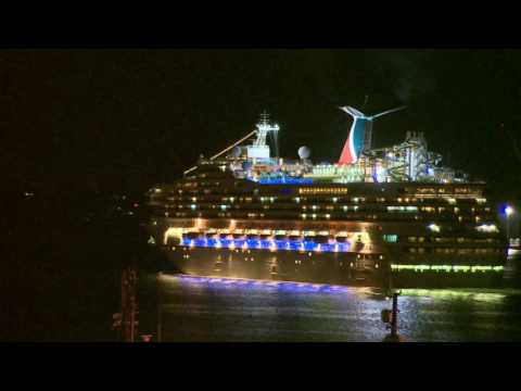 Brightly lit ships leave Halifax Harbour