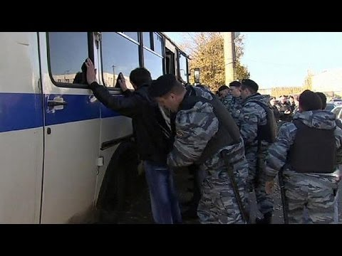 Russian Police Round Up Migrants In Wake Of Moscow Riot