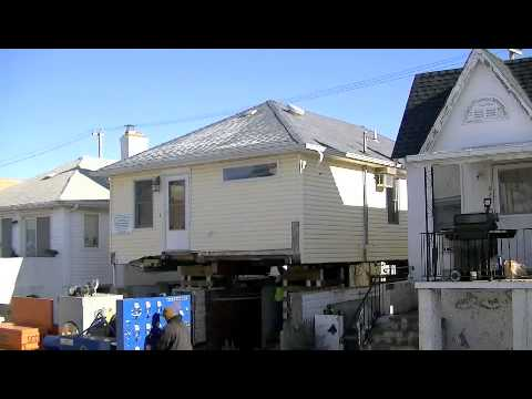 House lift in long beach ny youtube for Beach house lifts
