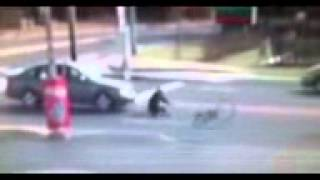 Man on bike gets hit by car