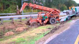 18 wheeler stuck in the mud - man improvises!