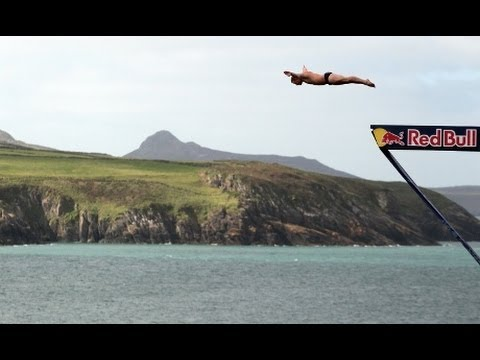 Divers take part in Round Six of the Red Bull Cliff Diving World series in Wales