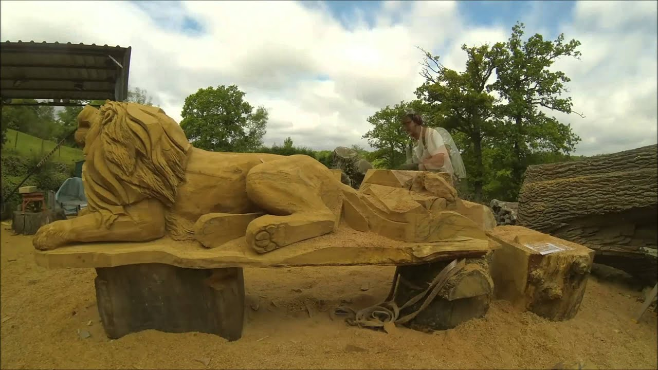 Chainsaw carving a lion and cub youtube