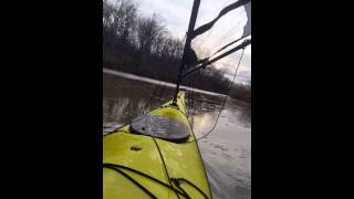 Kayak Sailing through a thin layer of ice Thumbnail