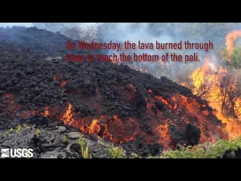 Kilauea lava tumbles down pali, reaches coastal plain