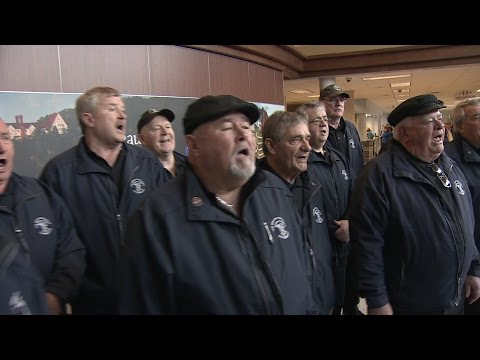 Cape Breton's Men Of The Deeps Treat Travellers To Airport Concert In Sydney, N.S.
